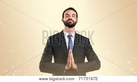 Businessman Zen Over Isolated Ocher Background