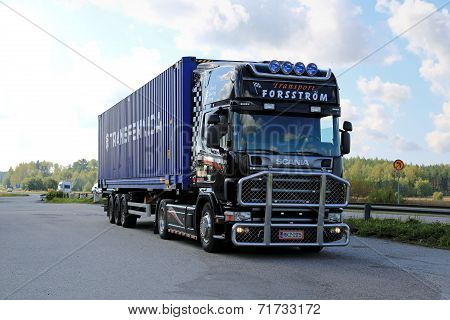 Black Scania Truck Hauls a Container