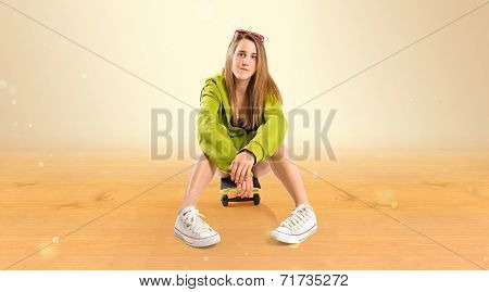 Blonde Girl With Skate Over Ocher Background