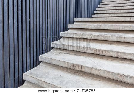 Cement Stairway With Blue Wood Wall In Modern Building.