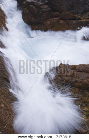 Seawater splash against  rocks.