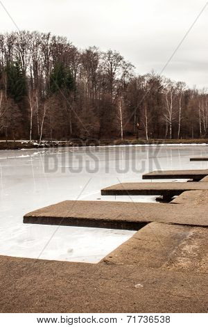 Dock near a frozen lake