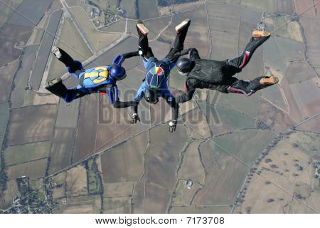 Close up of Three skydivers in freefall
