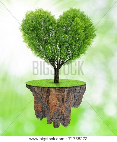 Little island and tree in the shape heart on green natural background
