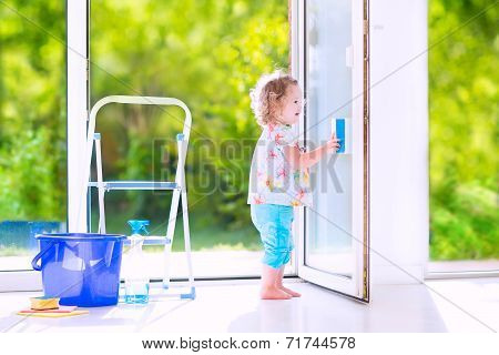 Little Girl Washing A Window