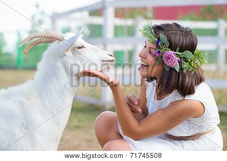 Funny Picture A Beautiful Young Girl Farmer With White Goat.