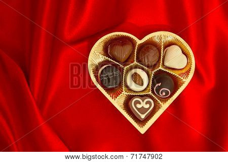 Chocolate Pralines In Golden Heart Shape Gift Box