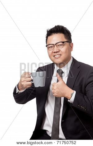 Asian Business Man Holding A Mug Of Coffee And Thumbs Up