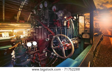 Inside Control Room Of Stream Engine Locomotive Train Parking On Trains Station Against Evening Ligh