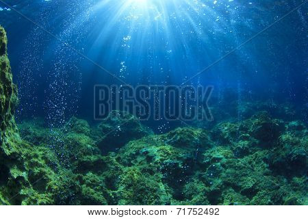 Underwater ocean scene with air bubbles, unfocused