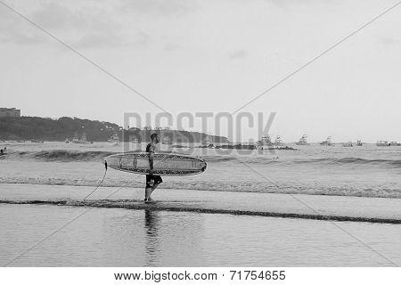 Surfer Walking To Ocean in Costa Rica