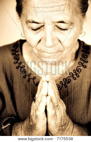 Christian Senior Woman Praying To God