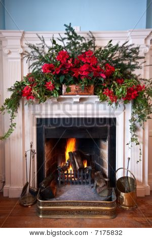 Beatifully Decorated Fireplace With Lit Fire