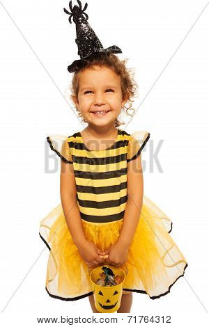 Little bee costume with candy Halloween bucket