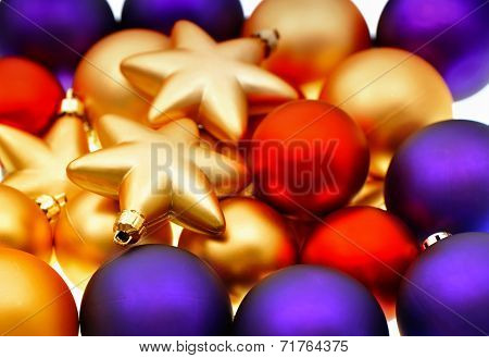 Closeup Of Lila, Red And Golden Baubles