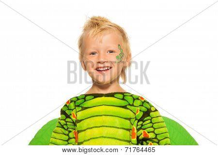 Close portrait of boy in dragon costume