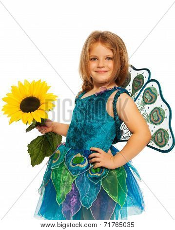 Little girl in costume of peacock