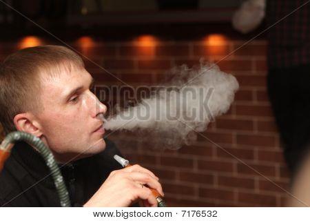 Man Resting At Hookah House