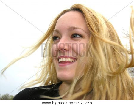 Woman With Wild Hair Blowing In Wind