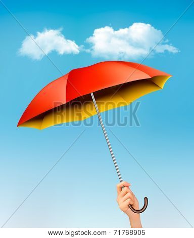 Hand holding a red and yellow umbrella against a blue sky with clouds. Vector.