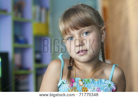 Portrait of little cute girl preoccupied in her room.