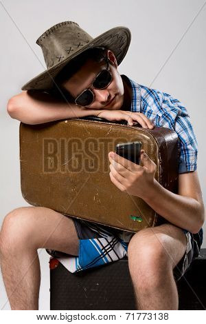 Man With A Suitcase Is Waiting Phone Call.