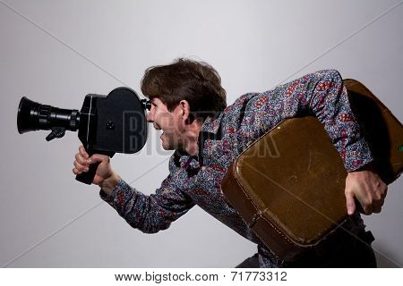 Portrait Of A Cameraman With Old Movie Camera.