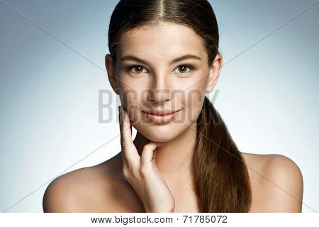 Beauty woman portrait of teen girl beautiful cheerful enjoying with long brown hair and clean skin