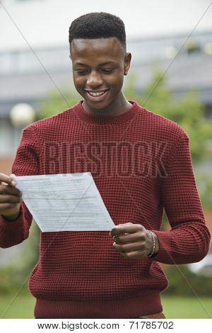 Teenage Boy Pleased With Good Exam Results