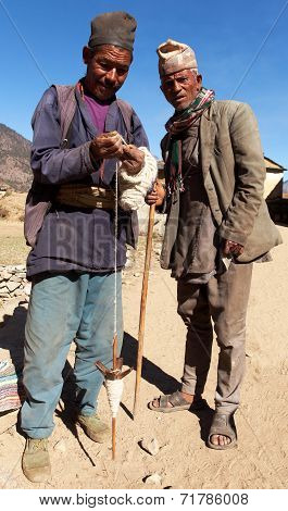 Nepalese Who Making Wool By Primitive Method