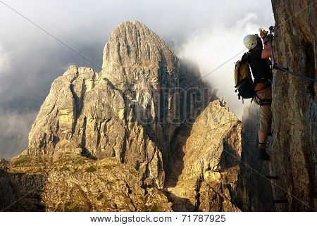 Climber On Via Ferrata Or Klettersteig In Italy