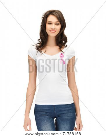 healthcare and medicine concept - smiling woman in blank t-shirt with pink breast cancer awareness ribbon