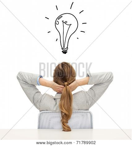 business, education, people and office concept - businesswoman or teacher in suit from back over white background with bulb doodle