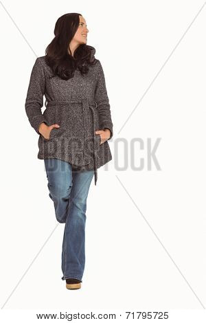 Woman standing and looking away on white background