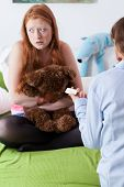 stock photo of teen pregnancy  - Worried mother gives her teenage daughter pregnancy test - JPG