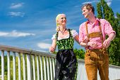 picture of national costume  - Couple visiting together Bavarian fair in national costume leather pants and Dirndl  - JPG