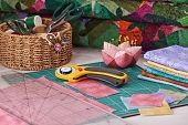 stock photo of quilt  - Accessories for patchwork while working on a quilt - JPG