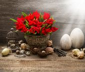 picture of nostalgic  - vintage easter composition with eggs and red tulips - JPG
