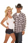 image of cowgirl  - a cowgirl and cowboy with smiles they are holding on to each other - JPG