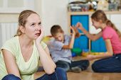 foto of upset  - exhausted mother frustrated and upset from children behaviour - JPG