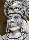 stock photo of yucatan  - Portrait of stone Mayan warrior on Yucatan Peninsula Mexico - JPG