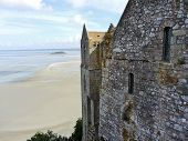 pic of mont saint michel  - view of Tombelaine island and tidal bay at low tide and wall of mont saint - JPG