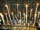 stock photo of altar  - Lighted candles on altar of cathedral Amiens France - JPG