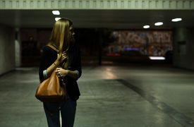 stock photo of underpass  - View of lonely woman in the underpass - JPG
