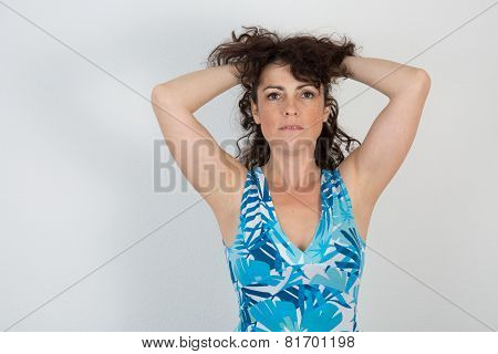 Portrait Of A Smiling Woman Touching Her Hair