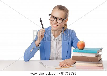 student  girl sit at the table, holding pen