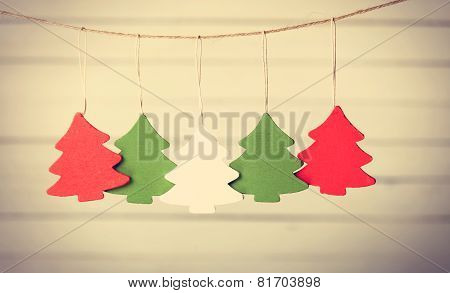 Five Christmas Tree Toys Hanging On Jute Thread.