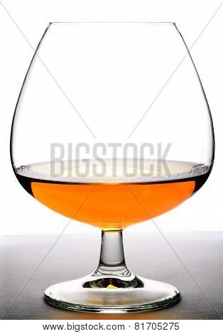 Glass with cognac on white background