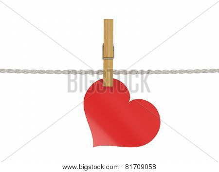 Red Heart Attached To A Clothesline With Pin Isolated On White Background