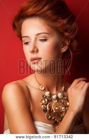 Portrait Of Redhead Edvardian Women With Necklace On Red Background.